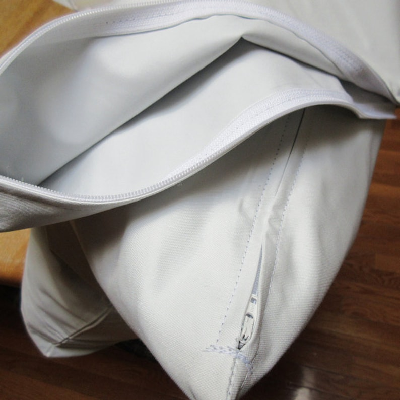Pesky down feather pillow andor cushion protectors with zipper enclosures